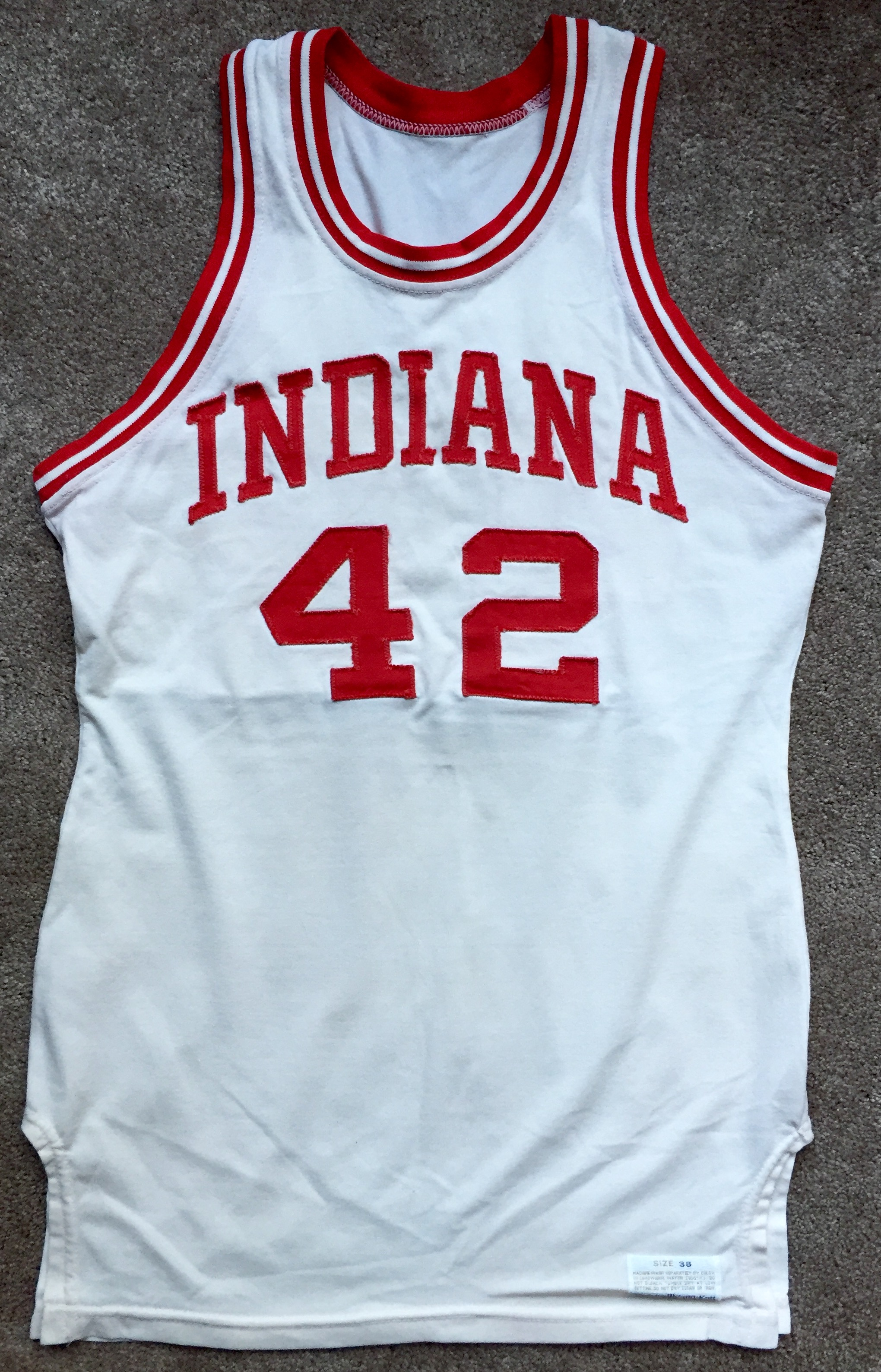 55952d5905a A 1976-77 Mike Woodson IU home jersey manufactured by Medalist Sand-Knit.