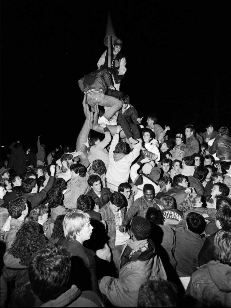 Hoosier fans celebrate on the IU campus following Indiana's 1987 NCAA Championship. Photo: courtesy of Indiana University Archives.